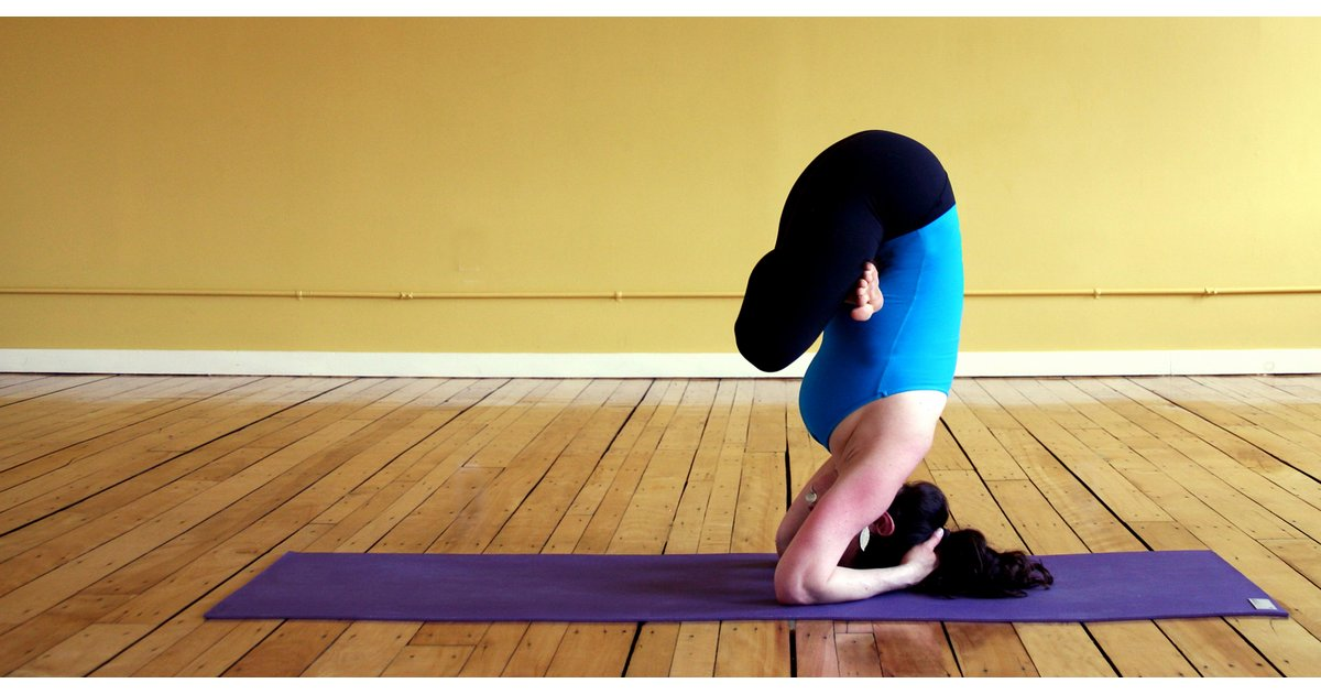 Challenging Yoga Pose Number 2 Headstand Along With Lotus Legs Extended Arms